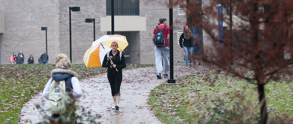 Students in the Rain at Student Center in Sugar Grove
