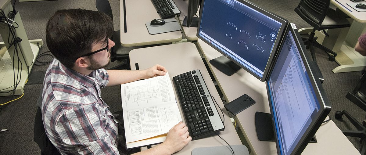 Student on computer in CAD lab L