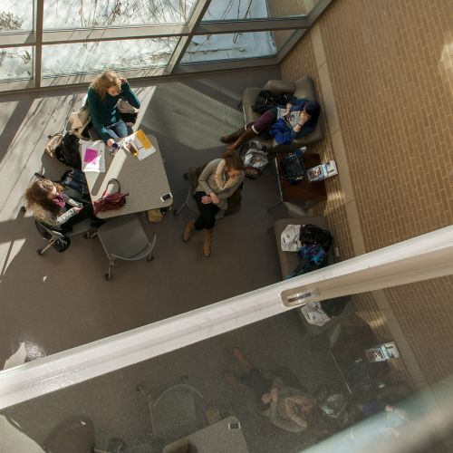 Students sitting at table aerial view S