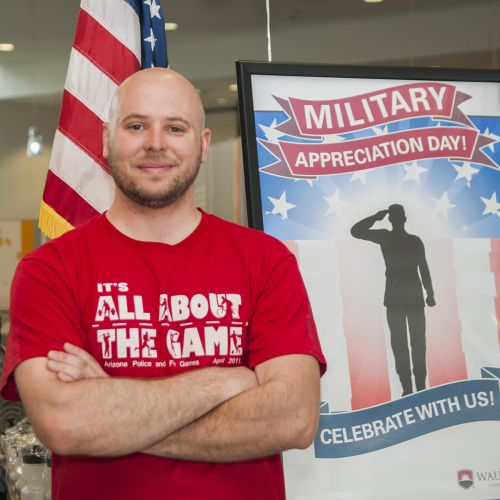 Veterans Day with Student Near Poster 2014
