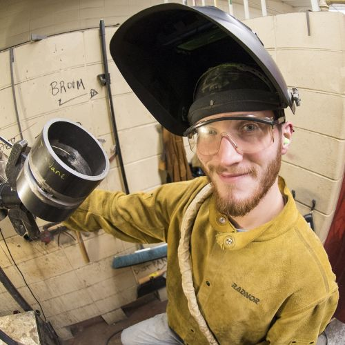 Student working in Welding Classroom
