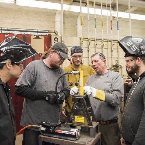 Faculty and students working in Welding Classroom